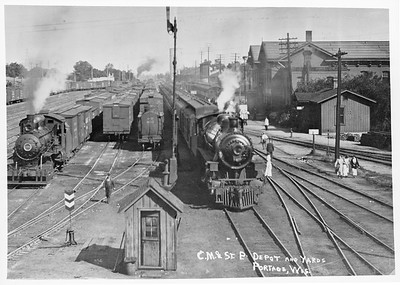 2018.15.L.6965--ed wilkommen 4.5x6.5 neg--CMStP&P--yard scene with depot and steam locomotive 2295 action--Portage WI--no date