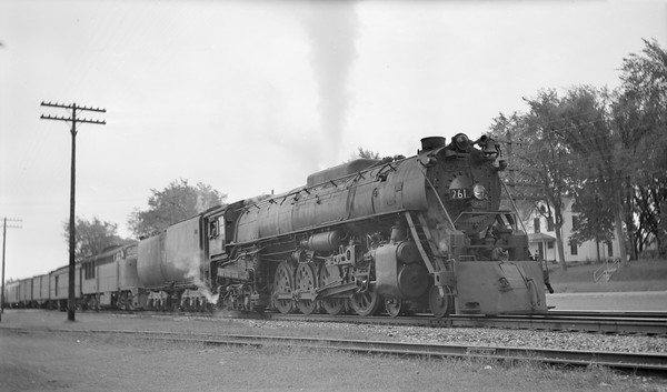 2018.15.L.6976--ed wilkommen pc neg--CMStP&P--steam locomotive 4-8-4 S3 261 with FM diesel and passenger train--Marion IA--no date