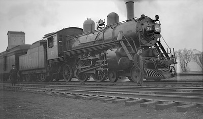 2018.15.L.6969--ed wilkommen pc neg--CMStP&P--steam locomotive 4-4-2 A1as 27 on passenger train--location unknown--no date