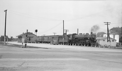 2018.15.L.6974--ed wilkommen pc neg--CMStP&P--steam locomotive 4-6-2 197 on passenger train at depot--Freeport IL--no date