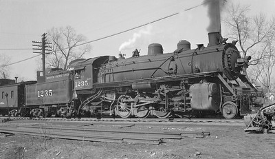 2018.15.N98A.7283--ed wilkommen 116 neg--MP--steam locomotive 2-8-2 1235 with caboose--location unknown--no date