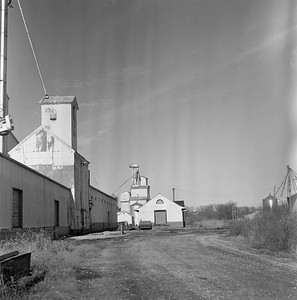 2018.15.N63.8963--ed wilkommen 120 neg--unknown road--abandoned tracks and depot scene--location unknown--no date