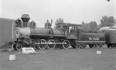 2018.15.N74A.5823--ed wilkommen 116 neg--D&RGW narrow gauge--steam locomotive 4-6-0 T-12 169 on display in park--Alamosa CO--1967 0800