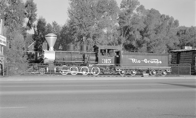 2018.15.N74A.5826--ed wilkommen 116 neg--D&RGW narrow gauge--steam locomotive 2-8-0 C-18 315 on display--Durango CO--1967 0800