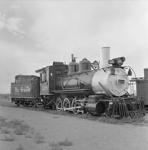 2018.15.N74A.5827B--ed wilkommen 120 neg--D&RGW narrow gauge--steam locomotive 2-8-0 C-18 318 on display--Alamosa CO--no date