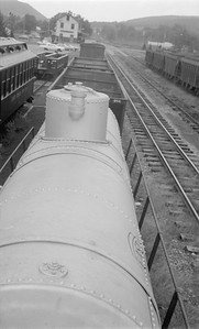2018.15.N50.1844--ed wilkommen 116 neg--EBT--freight cars and yard view with depot--Rockhill PA--1960s