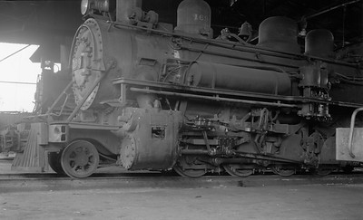 2018.15.N53A.1897--ed wilkommen 116 neg--FEGUA--steam locomotive 169 in house--Guatemala--1960s