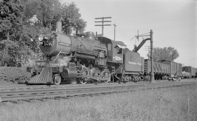 2018.15.N72.5645--ed wilkommen 116 neg--NP--steam locomotive 4-6-0 S-10 328 taking water--Wyoming MN--1946 0723