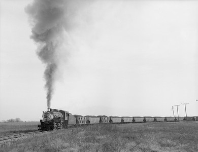 2018.15.N64.2705--ed wilkommen 3x4 neg--Galesburg & Great Eastern--steam locomotive 2-8-0 4 pulling coal loads action--location unknown--no date