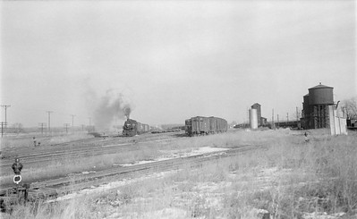 2018.15.N64.2711--ed wilkommen 116 neg--Galesburg & Great Eastern--yard scene with steam locomotive pulling cars--near Victoria IL--no date