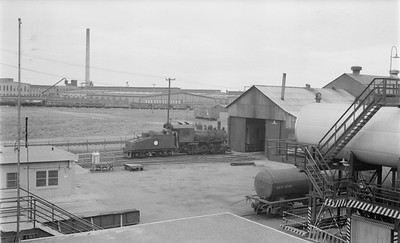 2018.15.N64.2770--ed wilkommen 116 neg--Koppers Co--steam locomotive 0-6-0 346 (ex SOO) at enginehouse scene--St Paul MN--no date