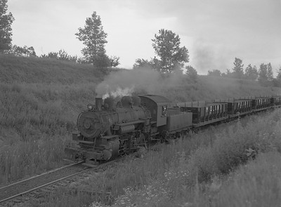 2018.15.N64.2827B--ed wilkommen 3x4 neg--Midland Electric Coal Corp--steam locomotive 0-6-0 84 with coal empties--Middle Grove IL--no date