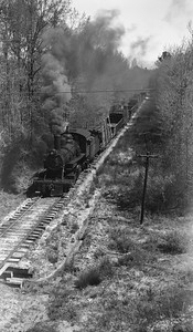 2018.15.N64G.8143--ed wilkommen 116 neg--Mobile & Gulf--steam locomotive 2-6-0 97 with freight train action--near Brownville AL--1962 0413