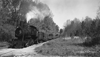 2018.15.N64G.8145--ed wilkommen 116 neg--Mobile & Gulf--steam locomotive 2-6-0 97 with freight train action--near Brownville AL--1962 0413