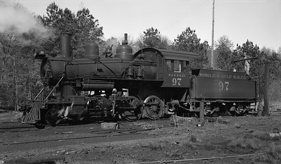 2018.15.N64G.8148--ed wilkommen 116 neg--Mobile & Gulf--steam locomotive 2-6-0 97 taking water--Brownville AL--1962 0413