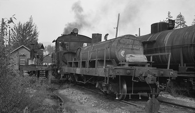 2018.15.N64L.8233A--ed wilkommen 116 neg--MacMillan Bloedel & Powell River--steam locomotive 2-8-0 1055 and auxilliary water tender--Vancouver Island BC--no date