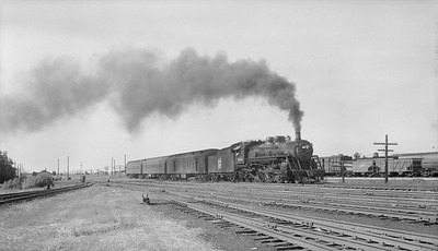 2018.15.N92.7731--ed wilkommen 116 neg--SOO--steam locomotive 4-6-2 H-3 734 on passenger train action--North Fond du Lac WI--no date