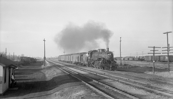 2018.15.N92.7087--ed wilkommen 116 neg--SOO--steam locomotive 4-6-2 H-22 2715 on passenger train 2 action--North Fond du Lac WI--no date