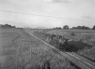 2018.15.N92.7744--ed wilkommen 3x4 neg--SOO--steam locomotive 4-6-2 H-22 2715 on passenger train--location unknown--no date
