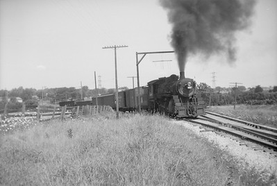2018.15.N92.7025--ed wilkommen 6x9 neg [Bob Boden]--SOO--steam locomotive 2-8-0 F-9 460 pushing cars into interchange action--Mukwonago WI--no date