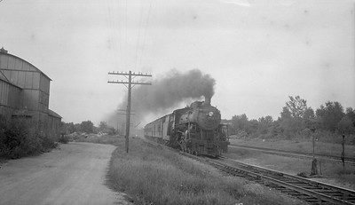 2018.15.N92.7740--ed wilkommen 116 neg--SOO--steam locomotive 4-6-2 H-21 2711 on passenger train at speed action--location unknown--no date