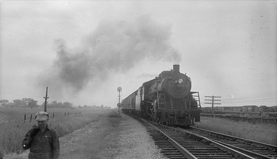 2018.15.N92.7738--ed wilkommen 116 neg--SOO--steam locomotive 4-6-2 H-21 2711 on passenger train action--location unknown--no date
