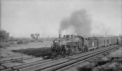 2018.15.N92.7735--ed wilkommen 116 neg--SOO--steam locomotive 4-6-2 H-23 2719 on passenger train action--Minneapolis MN--no date