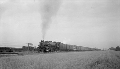 2018.15.N92.7737--ed wilkommen 116 neg--SOO--steam locomotive 4-8-2 N-20 4011 on passenger train action--location unknown--no date