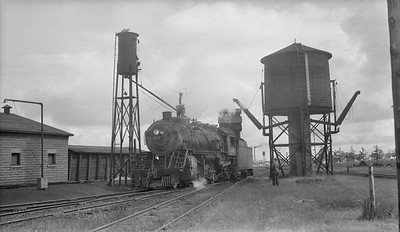 2018.15.N92.7739--ed wilkommen 116 neg--SOO--steam locomotive 2-8-2 L-1 1013 taking sand at engine servicing facility--location unknown--no date