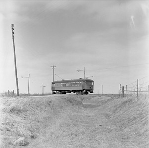 2018.15.N99G.8830--ed wilkommen 120 neg--Charles City Western--electric combine 50 on fantrip returning in countryside--near Charles City IA--c1956