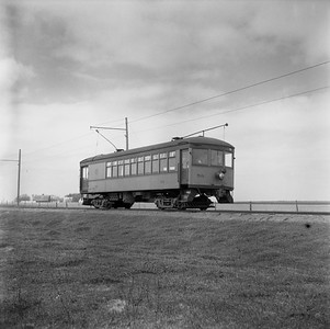 2018.15.N99G.8831--ed wilkommen 120 neg--Charles City Western--electric combine 50 on fantrip returning in countryside--near Charles City IA--c1956
