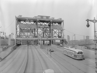 2018.15.N99E.7994--ed wilkommen 3x4 neg--CTA--Green Hornet PCC 7253 southbound Chicago River drawbridge at South Western Ave--Chicago IL--c1950s
