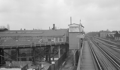 "2018.15.N99E.8002--ed wilkommen 116 neg--CTA--Hamline Yard junction and tower view--Chicago IL--mid 1960s. Used for access to Lower Hamlin Yard and for center track which was used as a ""yard."""