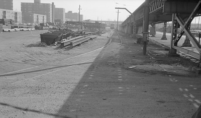 2018.15.N99E.8005--ed wilkommen 116 neg--CTA--lower 63rd Street yard view--Chicago IL--1960s. Looking south from 63rd Street. Where steel is stacked was the site of North Shore Line's Merchandise Dispatch freighthouse where box motors were loaded/unloaded.
