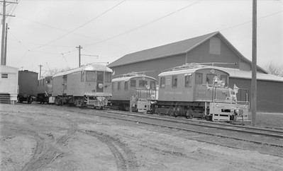 2018.15.N64.2747--ed wilkommen 116 neg--Iowa Terminal--yard scene with electric locomotives and freight motor--Emery IA--no date