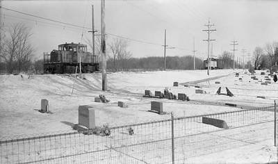 2018.15.N64.8277--ed wilkommen 116 neg--Municipality of East Troy--GE diesel locomotive waiting to meet freight motor M-15 scene--East Troy WI--c1970 0000