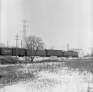 2018.15.N64.8881--ed wilkommen 116 neg--Municipality of East Troy--freight motor M-15 with freight train--near East Troy WI--c1956