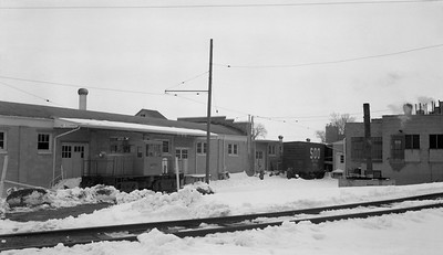 2018.15.N64.8820--ed wilkommen 116 neg--Municipality of East Troy--GE diesel locomotive switching United Milk Products industry scene--East Troy WI--c1970