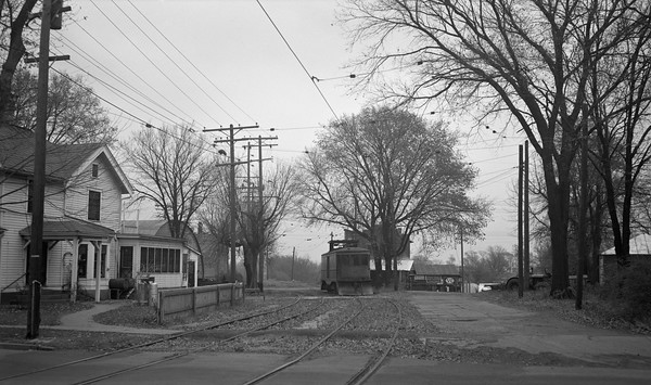 2018.15.N64.8263B--ed wilkommen 116 neg--Municipality of East Troy--freight motor M-15 arriving in town--East Troy WI--c1950s