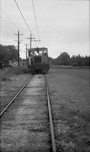2018.15.N64.8268--ed wilkommen 116 neg--Municipality of East Troy--GE diesel locomotive with freight cars--East Troy WI--c1970 0000