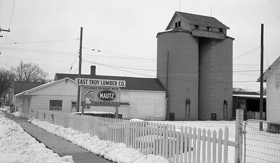 2018.15.N64.8816--ed wilkommen 116 neg--Municipality of East Troy--scene of lumberyard industry--East Troy WI--c1970