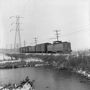 2018.15.N64.8879--ed wilkommen 116 neg--Municipality of East Troy--freight motor M-15 with freight train--near East Troy WI--c1956