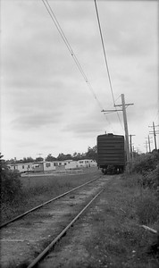 2018.15.N64.8265--ed wilkommen 116 neg--Municipality of East Troy--GE diesel locomotive with freight cars--East Troy WI--c1970 0000