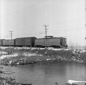2018.15.N64.8880--ed wilkommen 116 neg--Municipality of East Troy--freight motor M-15 with freight train--near East Troy WI--c1956