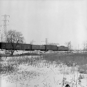 2018.15.N64.8882--ed wilkommen 116 neg--Municipality of East Troy--freight motor M-15 with freight train--near East Troy WI--c1956