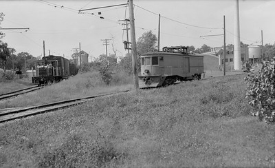 2018.15.N64.8274--ed wilkommen 116 neg--Municipality of East Troy--GE diesel locomotive with freight cars scene--East Troy WI--c1970 0000