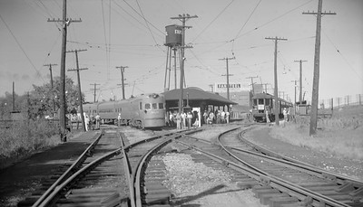 2018.15.N99B.7614--ed wilkommen 116 neg--CNS&M--electric interurban Electroliner passenger train meeting fantrip at station--North Chicago Jct IL--1955 0000