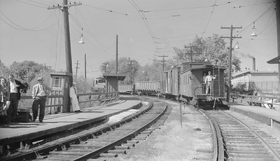 2018.15.N99B.7616--ed wilkommen 116 neg--CNS&M--northbound freight train passing through station off Shoreline route--North Chicago Jct IL--no date
