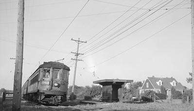 2018.15.N99B.7608--ed wilkommen 116 neg--CNS&M--electric interurban passenger train at Perpetual Adoration shelter--near Libertyville IL--1961 0800