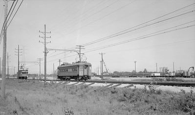 2018.15.N64.2956--ed wilkommen 116 neg--CSS&SB--electric interurban 2 train passing linecar 1100--location unknown--no date